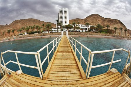 The wooden pier on a beach of Red sea in Eilat photo