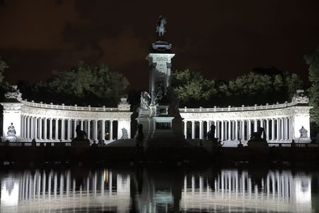 Silver fires of celebratory illumination of a colonnade in the Madrid park photo
