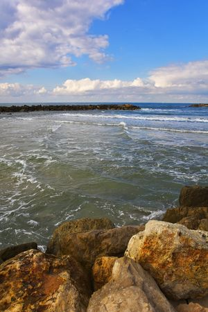 The winter sea. Coastal rocks on quay Tel Aviv Stock Photo - 5709280