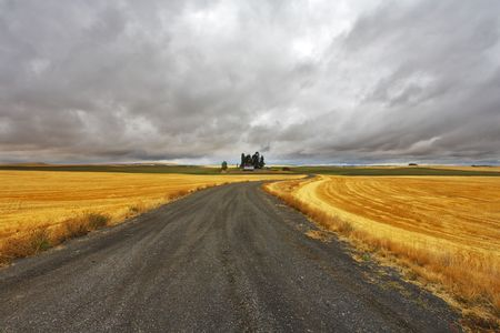 Thunder-storm above Montana. Fields after a harvest and road photo