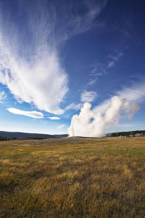 steam jet: The most well-known of the world geyser in Yellowstone national park - Old Faithful. The beginning of eruption