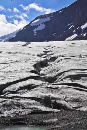 Enormous glacier in mountains of Northern Canada. Thawing edges photo