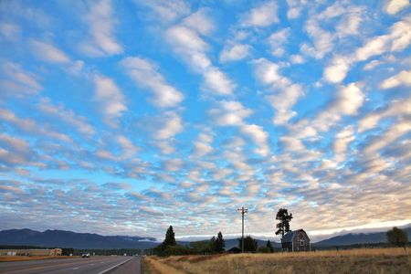 Picturesque clouds above the American road on a sunset Stock Photo - 5931687