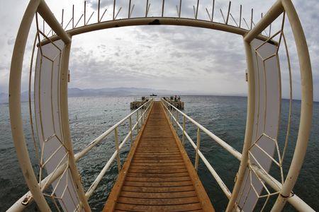 Door on wooden pier on beach of Red sea in Eilat  photo