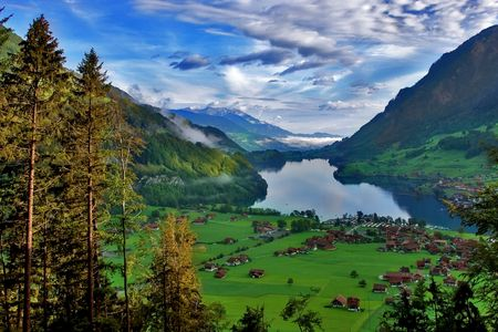 fells:  Lake, meadows and a village in Switzerland mountains