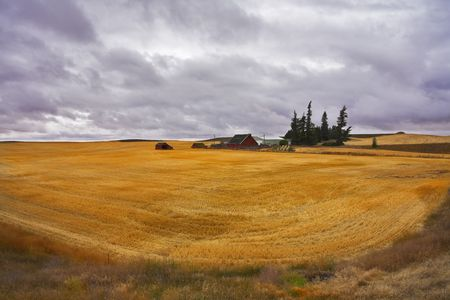 Small farm in fields of Montana after harvesting. More magnificent pictures from the American and Canadian National parks you can look hundreds in my portfolio. Welcome! photo
