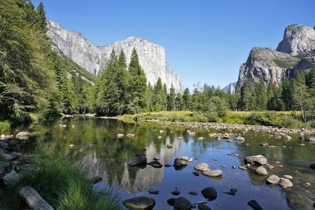 Well-known rocky monolith Эл -Captain are reflected in the river Mersed in Yosemite park photo