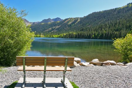 Empty bench on coast magnificent Gulllake in the early autumn. Travel across the USA photo