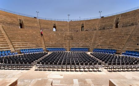 An amphitheater of the period of the Roman invasion in national park Caesarea on Mediterranean sea Stock Photo