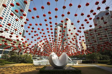 Traditional red lanterns and the modern abstract sculpture, decorating the Chinese city in New year photo