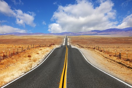 Excellent highway in California. Steppe and clouds photo