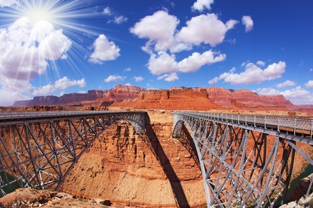 The famous double Navajo Bridge over the River Colorado separately for transport and for pedestrians. The sun is shining on a lovely autumn day photo
