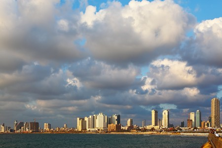 panorama of the waterfront in Tel Aviv. Sunset on a cloudy day photo