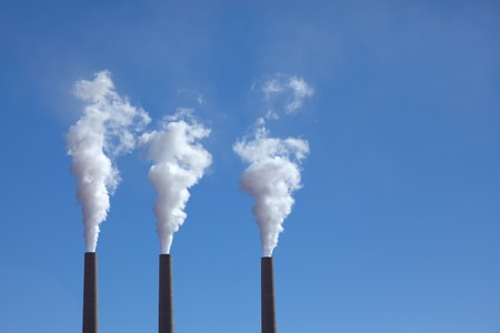 Three huge pipe smoke in the blue sky. Power to the Navajo Reservation photo