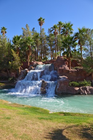 Oasis in desert. Magnificent cascade falls in the tourist centre photo