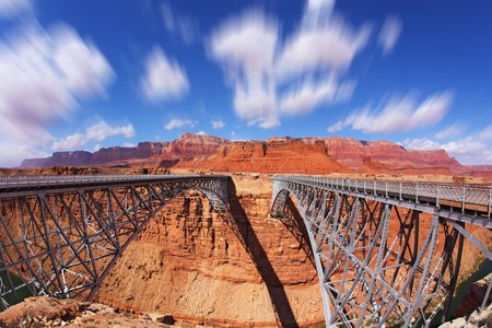 The famous double Navajo Bridge over the River Colorado separately for transport and for pedestrians. Clouds fly  photo