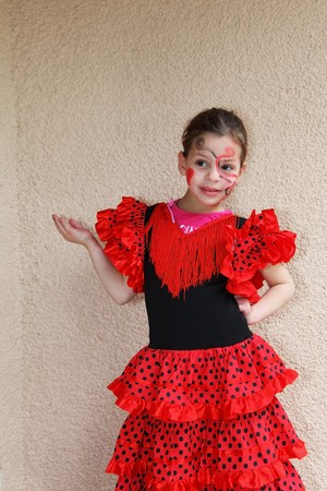 Lovely slim girl with a spectacular make-up dancing flamenco photo