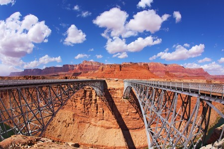 The famous double Navajo Bridge over the River Colorado separately for transport and for pedestrians photo