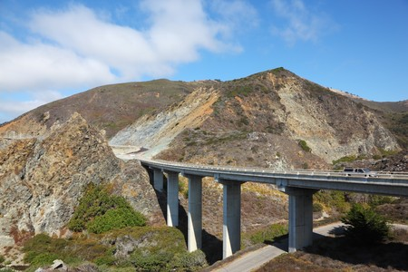 The magnificent bridge-viaduct on coastal highway of Pacific ocean photo