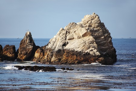 lobos: Picturesque rock, out of the water, near the Pacific coast USA