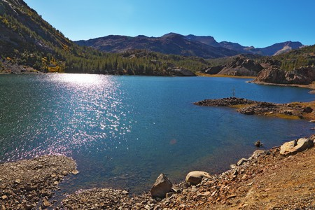 midday: Solar midday. Sparkling azure lake in national park Yosemite Stock Photo