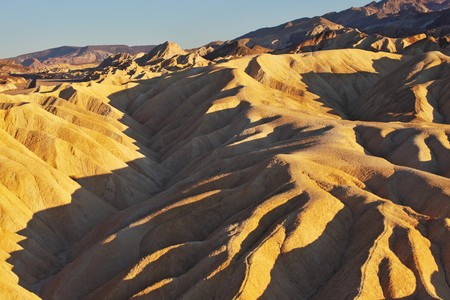 Pink sunset in Death Valley. Soft sand waves of the famous Zabriskie - Point photo