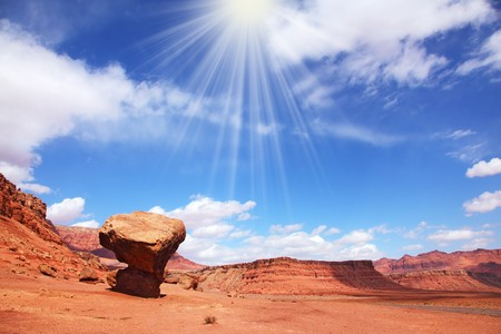 giant mushroom: Hot midday sun illuminates a giant stone mushroom - the result of weathering - in the red desert of the Colorado River Valley Stock Photo