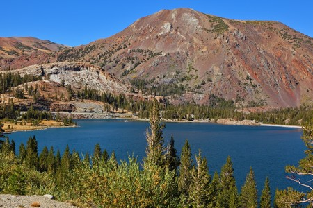 Lake Tioga on pass in an environment of picturesque mountains. Warm serene autumn day in Yosemite park of the USA, California Stock Photo - 8023723