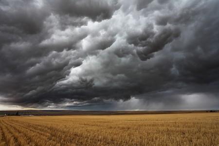 storm sky: Thunderstorm above fields after harvesting. Montana, the USA