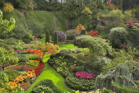 Phenomenally beautiful and picturesque garden for walks and supervision over flowers and trees Stock Photo
