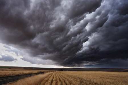 The autumn storm approaches on fields after harvesting. Montana, the USA photo
