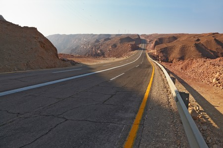 Magnificent highway in desert of Eilat in Israel. A sunset photo