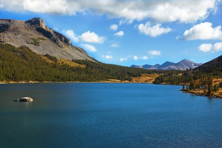 Magnificent gear tops of mountains and azure lake Tioga between them photo