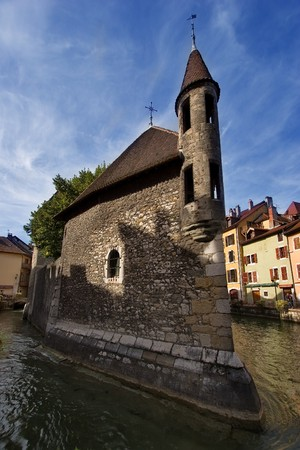 Antique prison in Annecy town on a bright sunny day   photo