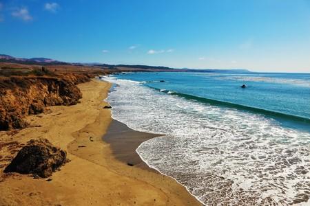 Deserted autumn beach at coast of the Pacific ocean photo