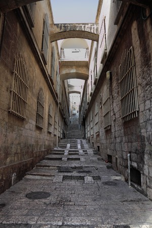 The great city of Jerusalem. Narrow and empty street in Christian quarter of the Old city Stock Photo - 8205315