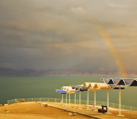 Magnificent rainbow during a spring thunder-storm on the Dead Sea photo