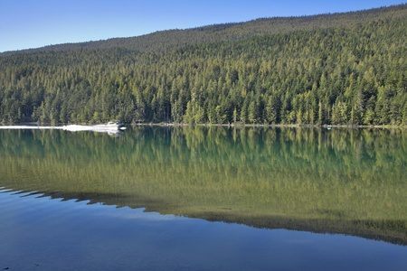 prompt:  Silent fishing lake and a prompt boat Stock Photo