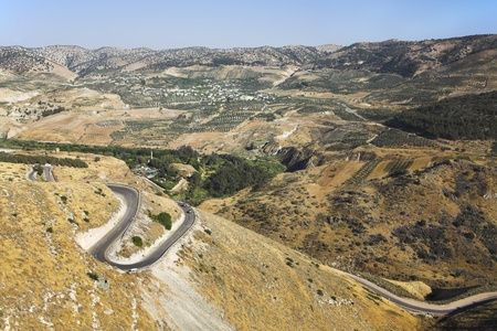 Road serpentine in mountains of Israel on border with Jordan photo