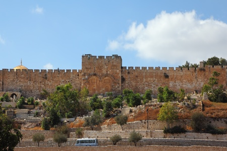 Ancient defensive walls in Jerusalem and the famous Golden Gate  Stock Photo