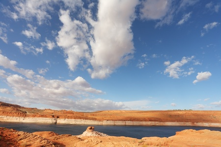 Red stone desert and the bright blue water. Lake Powell in a beautiful sunny day photo