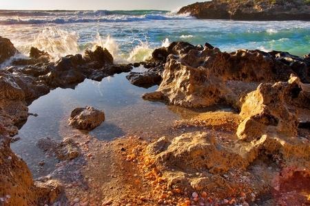 boulder:  Tiny creek on sea shore
