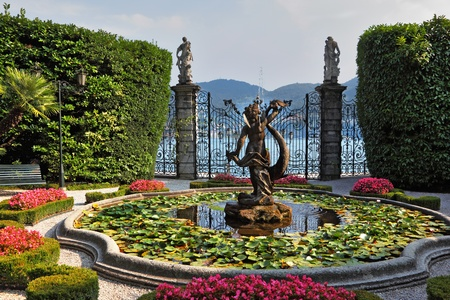 lake flowers: Lake Como, Villa Carlotta.  Magnificent park with fountains, statues, flower beds.