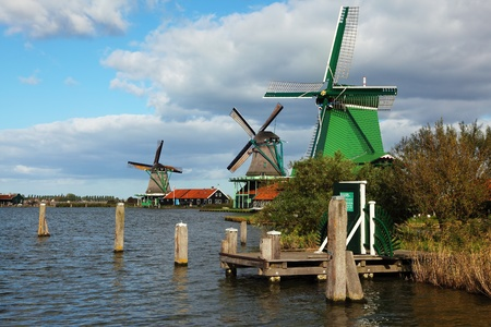 Ancient windmills and channels in museum ethnographic small town in Holland photo