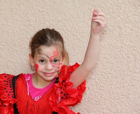 Lovely slim girl dancing flamenco in a red-black dress photo