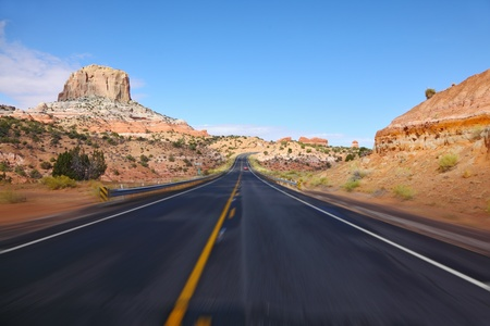 Tourism on high speed. The American highway in state of Utah, sunrise photo