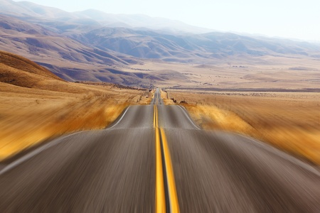 California, autumn day. Magnificent American road and fencings on roadsides from snow drifts