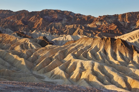 The famous section of Death Valley in California - Zabriskie Point. Picturesque hills of pink, yellow and chocolate hues at sunset  photo