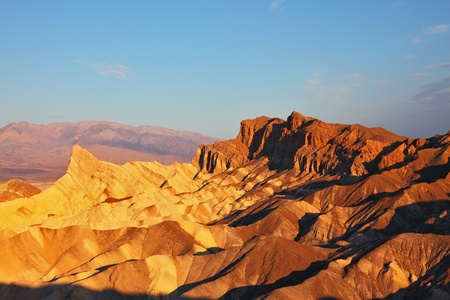 The well-known site of Death valley in California - the Zabriski-point. Picturesque hills of pink, yellow and chocolate shades on a sunset photo