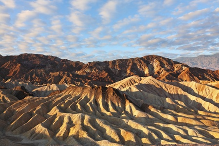 The famous section of Death Valley in California - Zabriskie Point. Picturesque hills of pink, yellow and chocolate hues. Sunset  photo